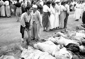 Koreans from Hamhung identify the bodies of some 300 political prisoners who were killed by the North Korean Army by being forced into caves which were subsequently sealed off so that they died of suffocation. October 19, 1950. Lt. Winslow. (Army)