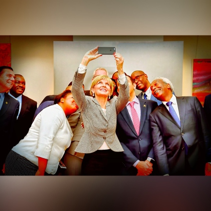 Foreign Minister Julie Bishop takes a selfie with Non-resident Accredited Ambassadors at Ambassador Miller's residence.
