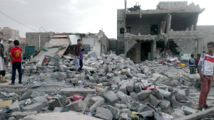 """""""Months after an airstrike on a neighborhood populated by black Yemenis, or """"Muhamasheen,"""" more than a hundred buildings still remain in rubble and survivors continue to search for any valuables, Sana'a, Yemen, Oct. 9, 2015."""
